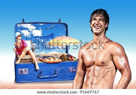Young woman in bikini in a pink suitcase with muscular man standing in front  - Travel concept - stock photo