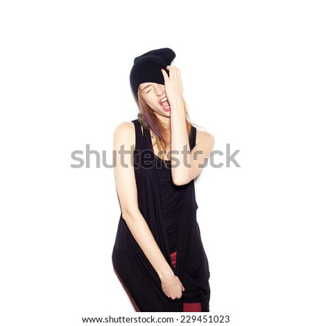 young woman in black beanie . Beautiful Girl opening Mouth. Emotion.  Hairstyle. Makeup.  White background, not isolated - stock photo