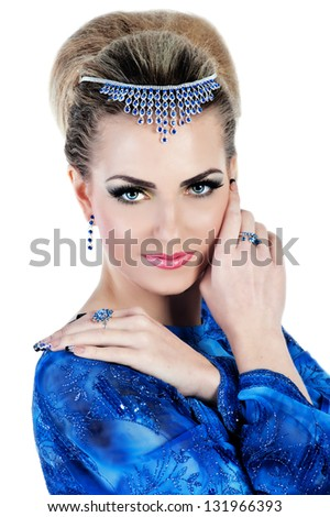 Young woman in blue dress with bright make up and evening hairstyle - stock photo