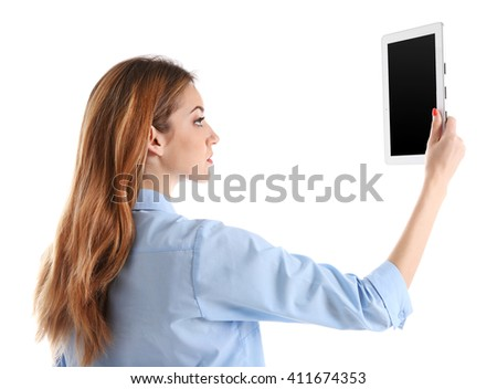 Young woman in blue shirt using tablet, isolated on white - stock photo