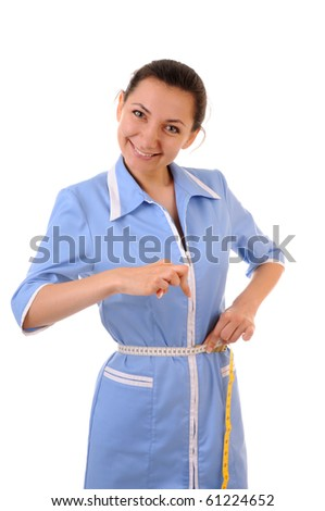 Young woman in blue uniform shows how her waist is thin. Isolated on white background. - stock photo