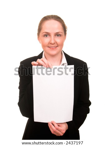 Young woman in business suit showing a sheet of paper in front of her smiling isolated on white - stock photo