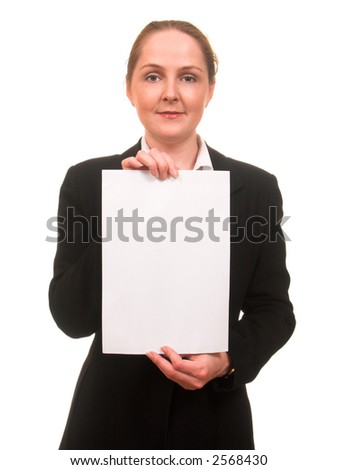 Young woman in business suit showing a sheet of paper in front of her smiling isolated on white with copyspace - stock photo