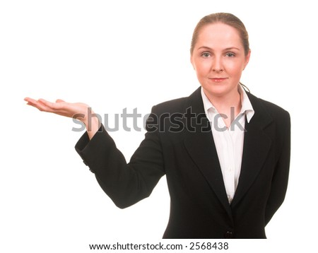 Young woman in business suit showing something with a hand smiling isolated on white with copyspace - stock photo