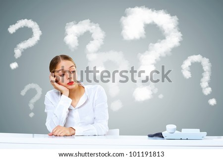 Young woman in business wear generating ideas in office - stock photo