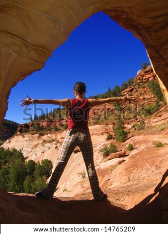 young woman in canyon, Arizona, US - stock photo