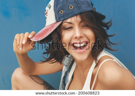 Young woman in cap. Lifestyle portrait - stock photo