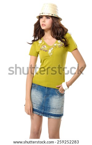 young woman in cap standing posing   - stock photo