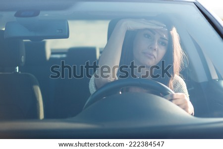 Young woman in car. Portrait of beautiful young Caucasian woman in car.  - stock photo