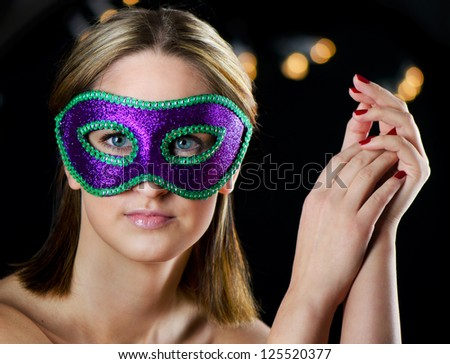 Young woman in carnival mask - stock photo