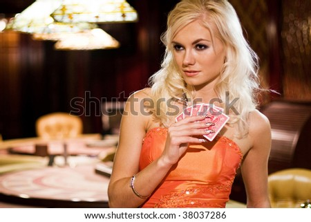 Young woman in casino - stock photo