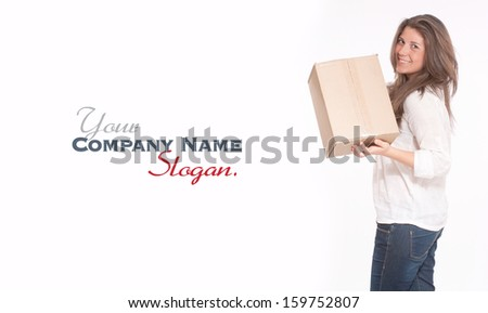 Young woman in casual clothes carrying a box  - stock photo