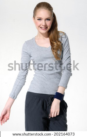 young woman in casual clothes posing for the camera - stock photo