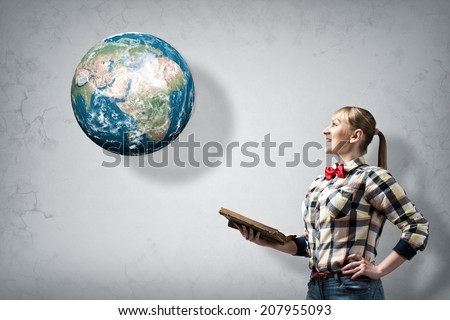 Young woman in casual with book in hands. Elements of this image are furnished by NASA - stock photo