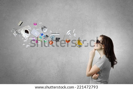 Young woman in casual with icon flying above - stock photo