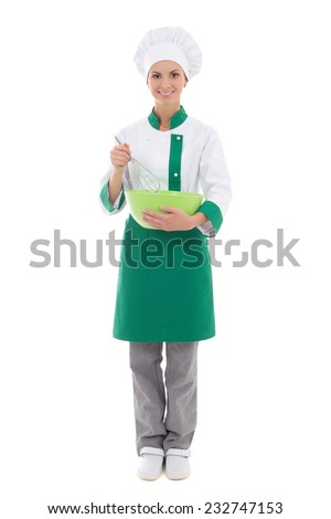 young woman in chef uniform mixing something in green plastic bowl - full length isolated on white background - stock photo