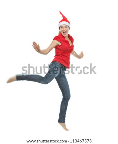 Young woman in Christmas hat jumping - stock photo