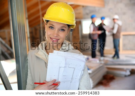 Young woman in construction professional training - stock photo