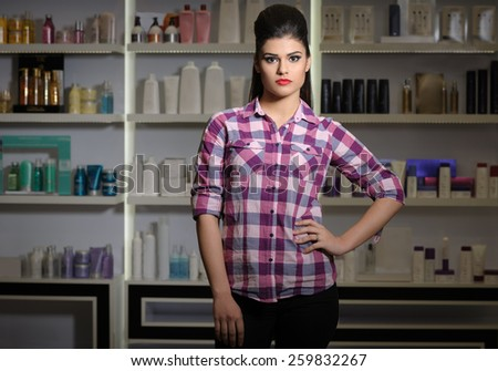 Young woman in cosmetics shop - stock photo