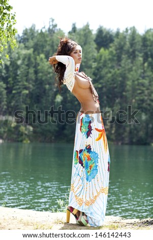 Young woman in costume of American Indian  - stock photo
