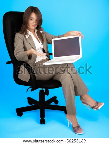 Young woman in costume with laptop on the blue background - stock photo