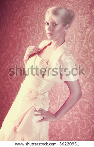 Young woman in dress. Red and yellow tint. - stock photo