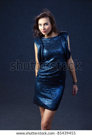 young woman in evening dress, professional make-up. - stock photo