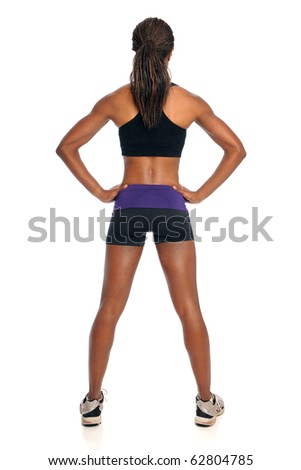 Young woman in exercise outfit standing in back view isolated over white background - stock photo