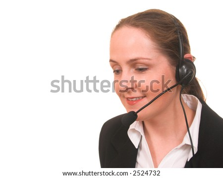 Young woman in formal suit with phone headset smiling isolated on white with copyspace - stock photo