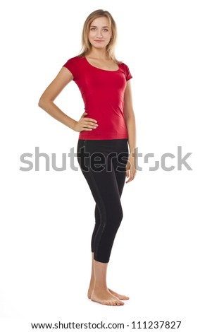 Young woman in full growth in the studio in red on a white background - stock photo