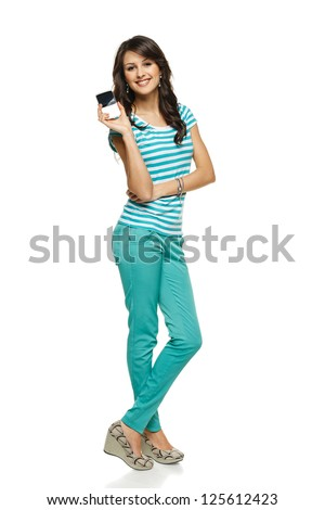 Young woman in full length showing her mobile phone / blank card with copy space, over white background - stock photo