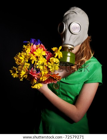 Young woman in gas mask. - stock photo
