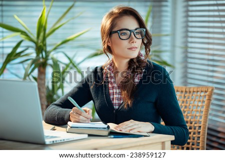 Young woman in glasses studying  - stock photo