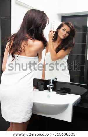 Young woman in her bathroom. - stock photo