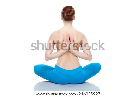 young woman in medi8tation on white background. Sitting back. Naked - stock photo