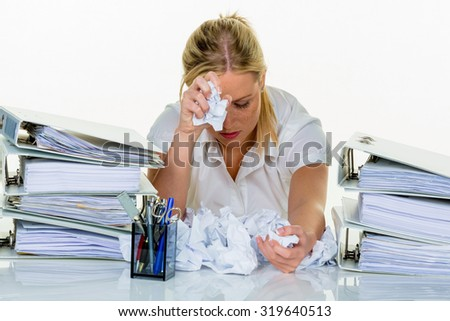 young woman in office is overwhelmed with work. burnout at work or study. - stock photo