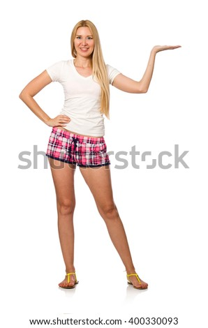 Young woman in pink plaid shorts isolated on white - stock photo