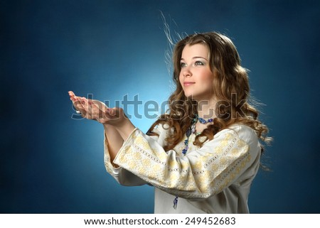young woman in prayer to God. good wavy hair. family values. belief in a happy life - stock photo