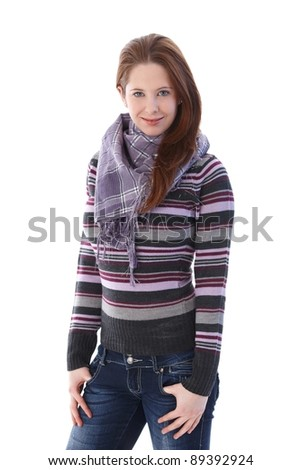 Young woman in pullover and scarf smiling.? - stock photo