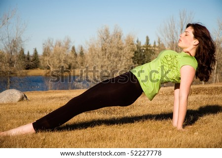 Young woman in purvottanasana yoga pose. - stock photo