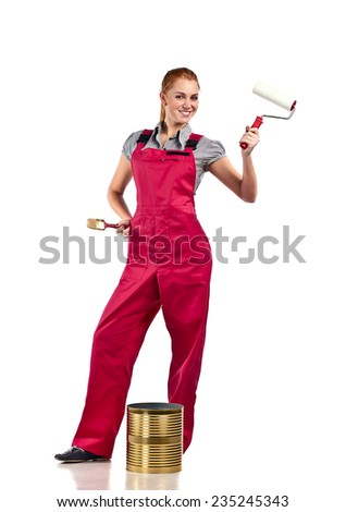 Young woman in red overalls with painting tools , isolated on white - stock photo