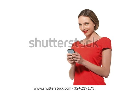 Young woman in red texting on smart phone - isolated with copy space - stock photo