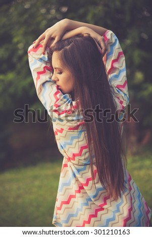 young woman in retro look hippie dress outdoor in nature - stock photo