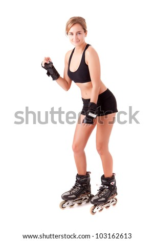 Young woman in rollerskates - fitness concept - stock photo