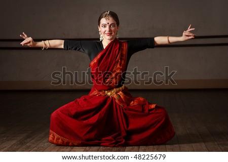 Young woman in sari dancing classical traditional indian dance Bharat Natyam - stock photo