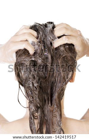 Young woman in shower washing her hairs isolated on white background - stock photo