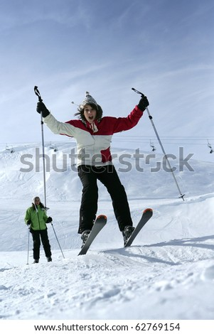 Young woman in snowy landscape - stock photo