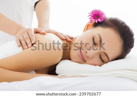young woman in spa salon getting massage - stock photo