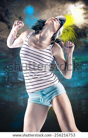 young woman in sport dress dancing in aerobic or reggaeton or hiphop style - stock photo