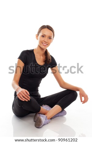 young woman in sport wear over white background - stock photo